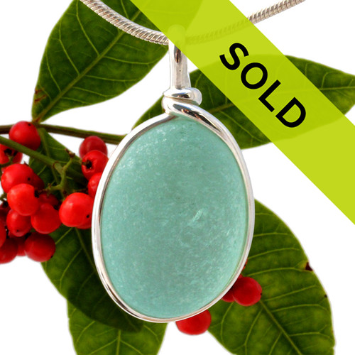 A lovely perfect piece of beach found glass from Seaham England in a stunning vivid aqua blue is set in our Original Wire Bezel© pendant setting. Sorry this sea glass jewelry item has been sold!