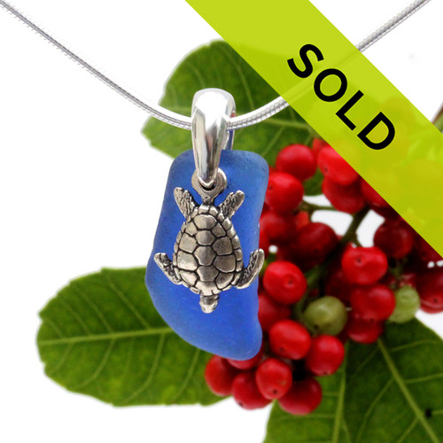 """Petite cobalt blue sea glass set on a solid sterling cast bail with a sterling silver sea Turtle charm. The sea glass necklace comes on our 18"""" solid sterling smooth snake chain (SHOWN and included) Sorry this necklace has sold."""