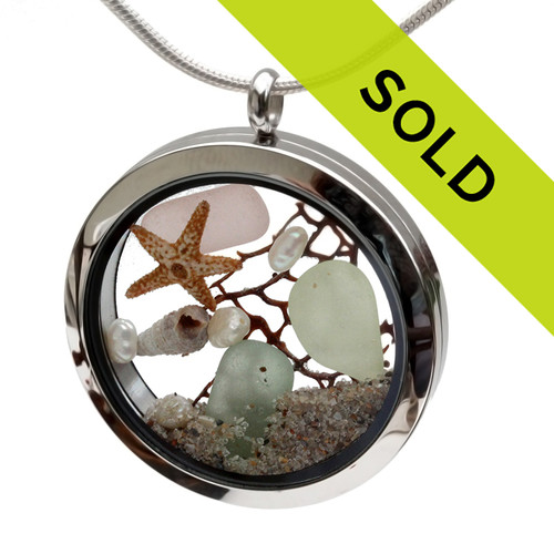 Genuine pale green ,seafoam and a piece of rare peach sea glass piece combined with a real shells, sea fan, pearls and a real beach sand in this JUMBO 35MM stainless steel locket. Sorry this sea glass jewelry piece has been sold!
