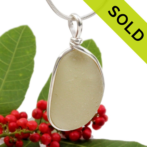 Light gold natural sea glass piece set in our Original Wire Bezel setting in sterling silver. Shown here on our 2MM snake chain which is available as an upgrade.