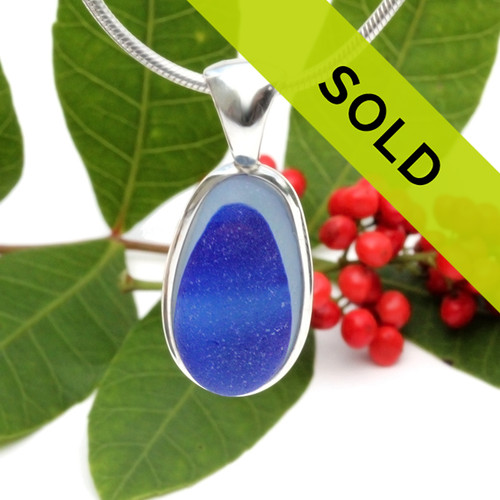 This sea glass is fused electric blue inside a base of pure white.  It is set in our  sterling silver Deluxe Wire Bezel© setting. Very Versatile and elegant. CLASSIC!  Sorry this one of a kind sea glass necklace pendant has been sold!