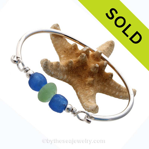 Two bright blue recycled glass beads set with a single vivid seafoam green sea glass piece and sterling details on a solid sterling half round bangle bracelet. Sorry this Sea Glass Jewelry selection has been SOLD!