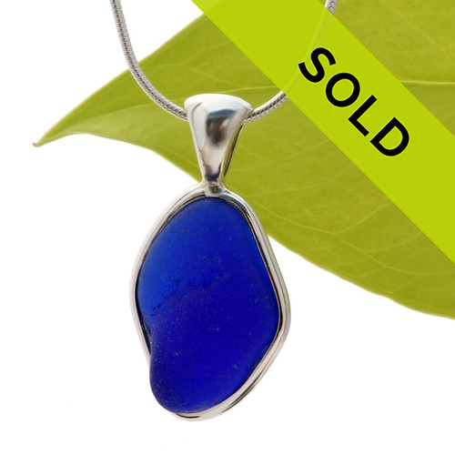 This is a LARGE Carolina Blue color and an old thicker piece of naturally found sea glass in my Original Sterling Silver Wire Bezel©