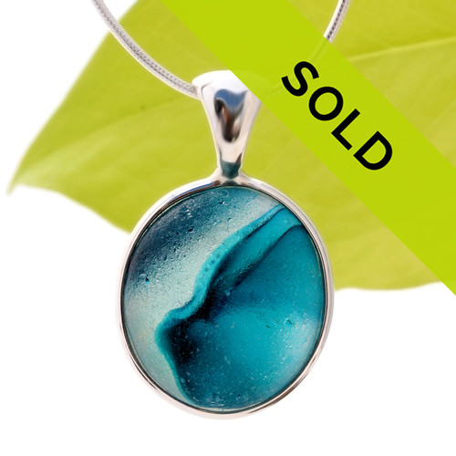 A vivid teal blue in a clear base. A stunning piece of beach found English sea glass set in a solid sterling silver bezel setting. Sorry this ultra rare sea glass jewelry piece has been sold!