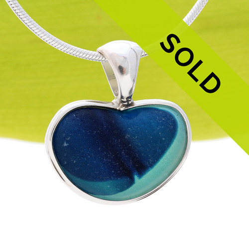 A  natural beach found mixed blue aqua green sea glass heart set in our Deluxe Wire Bezel© A great necklace for any time of year and perfect for any sea glass lover! Sorry this sea glass jewelry piece has been SOLD!