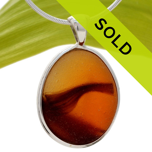 This amazing endoday English sea glass piece is one of the RAREST pieces we have ever offered. Set in our Deluxe Silver Bezel Setting. Sorry this one of a kind Ultra Rare sea glass jewelry piece has been sold!