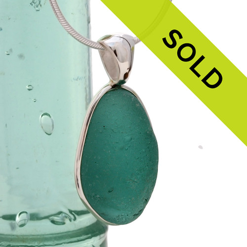 A large chunky  vivid aqua green in this very old English Sea Glass piece and set in our Original Wire Bezel© necklace pendant setting. Sorry this sea glass jewelry item has been sold!