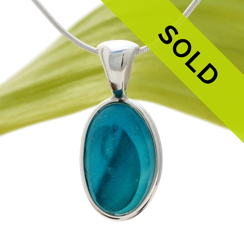 A  natural beach found mixed vivid aqua sea glass set in our Deluxe Wire Bezel© Sorry this sea glass jewelry piece has been sold!