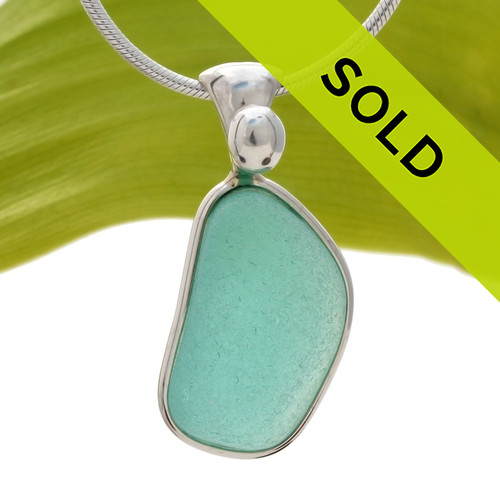 A large bright vivid aqua green in this very old English Sea Glass piece and set in our Original Wire Bezel© necklace pendant setting. Sorry this sea glass jewelry piece has been sold!