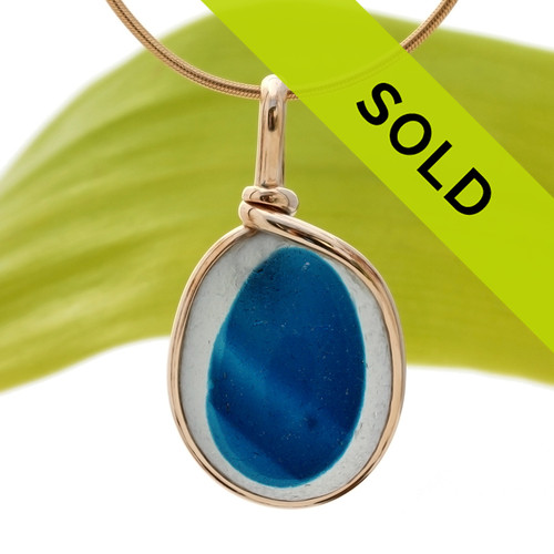 This is a stunning piece of longer mixed teal blue EndODay sea glass set in our Original Wire Bezel© pendant setting in gold. Classic and timeless. Sorry this sea glass jewelry piece has been sold!