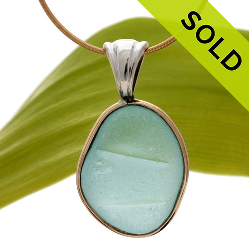 A nice piece of embossed aqua blue sea glass set in a mixed metal gold and sterling silver necklace. SOLD - Sorry this Sea Glass Jewelry piece is NO LONGER AVAILABLE!