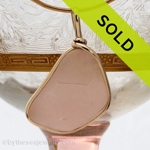 A top quality piece of RARE embossed perfect peach or pink glass set in our Original Wire Bezel© 14K G/F sea glass pendant setting. Sorry this piece of Sea Glass Jewelry has been SOLD