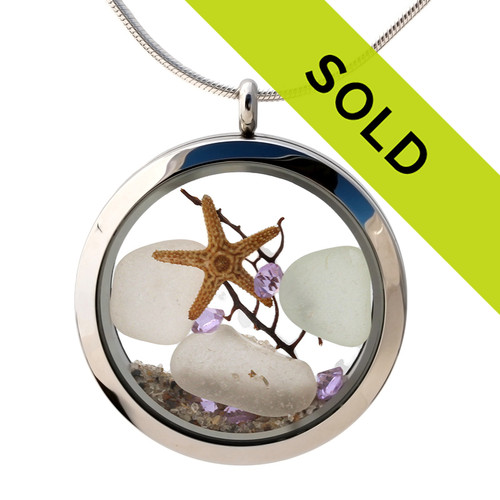 Pure white sea glass combined with a baby starfish and beach sand in this twist top stainless steel locket necklace. Bright Amethyst gem beads make this a great gift for anyone with a February Birthday! Sorry this sea glass jewelry item has been sold!