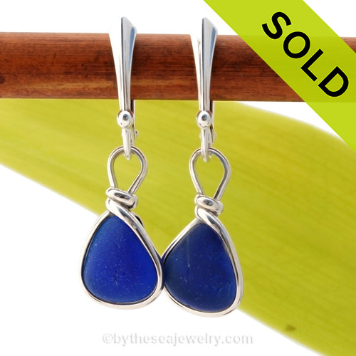 Vivid petite cobalt blue sea glass pieces set in our Original Wire Bezel© setting. This pair comes on quality sterling silver leverback ear wires. Sorry these Sea Glass Earrings have been SOLD!