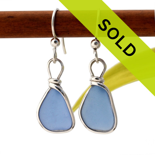 A beautiful pair of natural Carolina Blue beach found sea glass earrings set in our Original Wire Bezel© silver setting that leaves the sea glass TOTALLY UNALTERED from the way it was found. Sorry, this sea glass jewelry selection is no longer available.