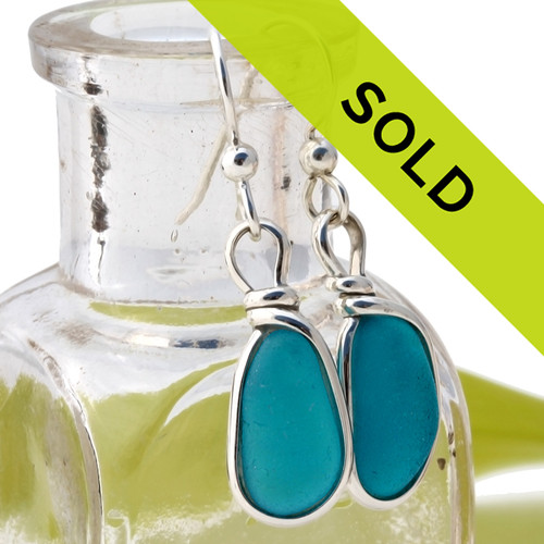 Vivid Electric Aqua Victorian Sea Glass pieces from Seaham England are set in our Original Wire Bezel© earring setting. This is a very hard sea glass to match and this photo is true to color, subtle variances in the aqua shade can be seen.