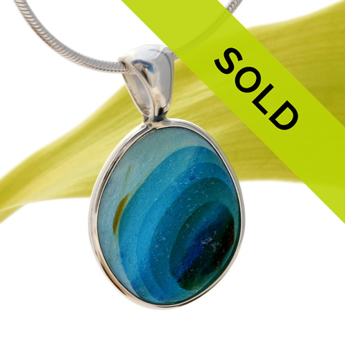 An incredible mixture of blues, green and a touch of gold in this one of a kind ULTRA RARE sea glass bezel pendant. Sorry this sea glass jewelry piece has been sold!