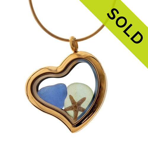A stunning gold tone stainless steel locket necklace with blue and seafoam green beach found sea glass and a real starfish. Sorry this Sea Glass Jewelry selection is NO LONGER AVAILABLE!