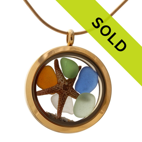 A gold tone stainless steel locket necklace with jeweltone sea glass pieces, a real starfish and beach sand! Sorry this sea glass jewelry selection has been sold!