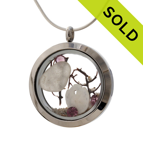 February Sea Glass & Birthstone Locket - White sea glass combined with a real sandollar,seafoam and and brightened up with purple or amethyst gems in a Large 30MM  Locket.  Sorry this Sea Glass Jewelry selection has been SOLD!