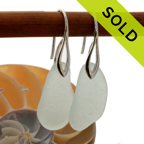 A pair of natural surf tumble sea glass earrings in an seafoam green on sterling deco hooks. Sorry these Sea Glass Earrings have been SOLD!