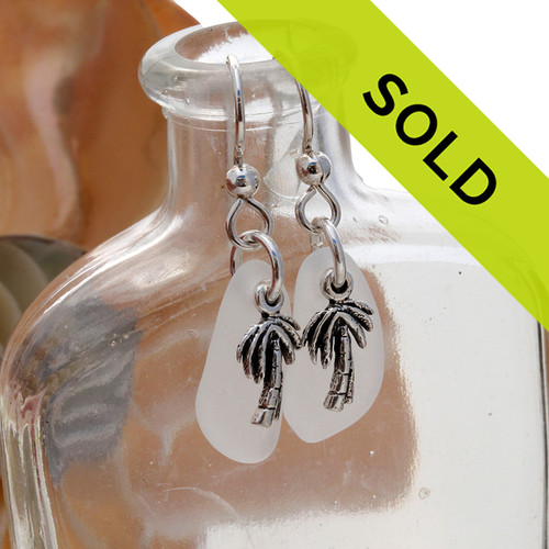 Genuine sea glass earrings with white sea glass and sterling silver palm tree charms. Sorry this sea glass jewelry is no longer available.