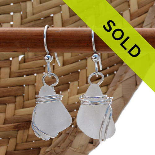 Perfect natural triangles of pure white sea glass set in a solid sterling silver setting. Sorry these sea glass earrings have been sold!