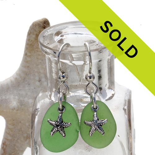 A simple pair of genuine green sea glass earrings with starfish charms in a lightweight simple setting. Sorry these sea glass earrings have been sold!