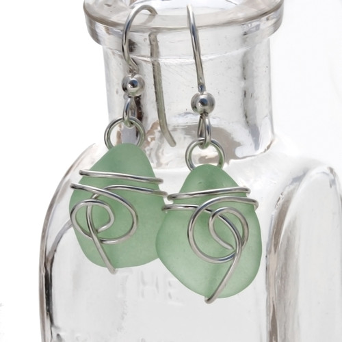 Seafoam Green sea glass pieces set in a simple sea inspired sterling silver for a lovely petite pair of sea glass earrings.