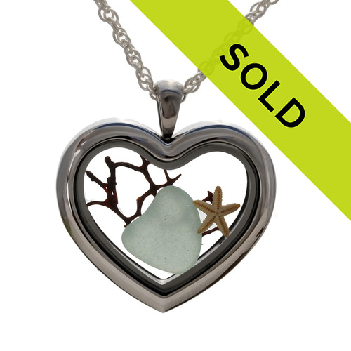 A Seafoam Green sea glass heart, bit of seafan and a small starfish combined a heart locket in this sea glass locket necklace. Sorry this sea glass jewelry selection has been sold!