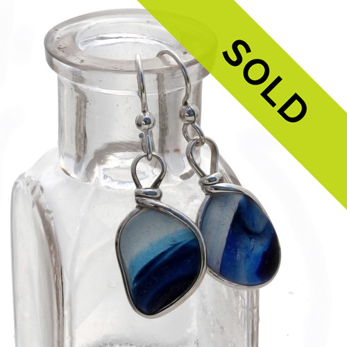 Unusual and hard to match cross sectioned multi End Of Day sea glass from England set in our Original Wire Bezel© sea glass earring setting. This is a VERY HARD sea glass to match and is a once in a lifetime pair! Sorry this sea glass jewelry selection has been sold!