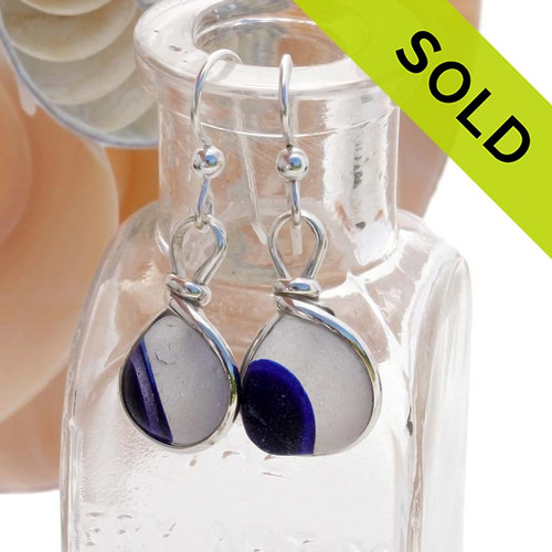 Rare one of a kind sea glass earrings with multi color sea glass from Seaham England. This is INCREDIBLY HARD sea glass to match in pairs due to it's uniqueness! SOLD - Sorry these Ultra Rare Sea Glass Earrings are NO LONGER AVAILABLE!