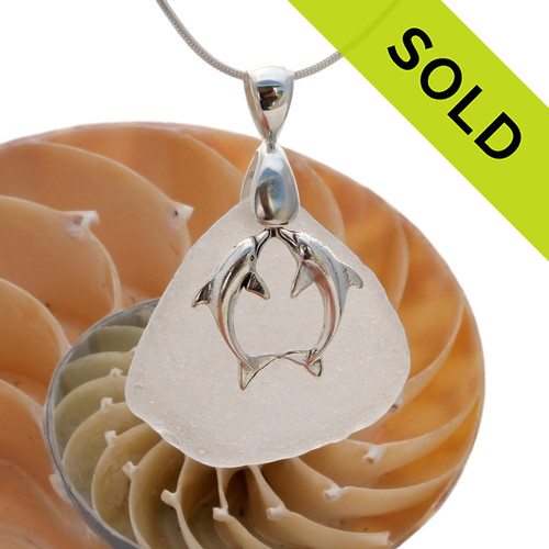 A stunning piece of white GENUINE sea glass pendant with a LARGE SOLID STERLING kissing dolphins charm. Sorry this Sea Glass Jewelry selection has been SOLD!