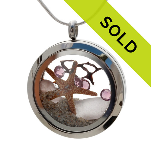 Sorry this sea glass jewelry item has been sold! February Sea Glass & Birthstone Locket Purple or Amethyst RARE sea glass combined with a real starfish, vintage seafan and and brightened up with purple or amethyst gems in a 30MM  Locket.