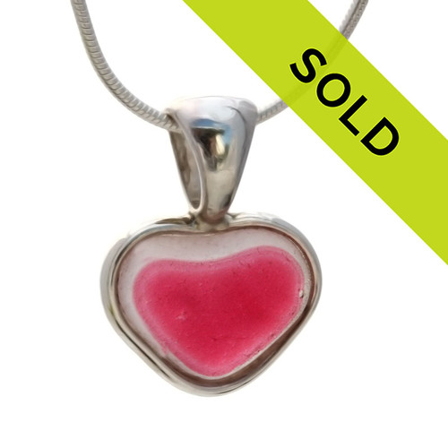 A  natural beach found mixed petite vivid pink  flashed sea glass heart set in our Deluxe Wire Bezel© A great necklace for any time of year and perfect for any sea glass lover! Sorry this ultra rare sea glass jewelry piece has been sold!