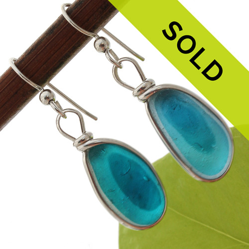 A stunning match of totally natural sea glass pieces from Seaham England set in our Original Wire Bezel© earring setting. This setting leaves the sea glass UNALTERED from the way it was found on the beach! An ULTRA Rare pair!  Sorry this once in a lifetime pair of teal sea glass earrings has SOLD!