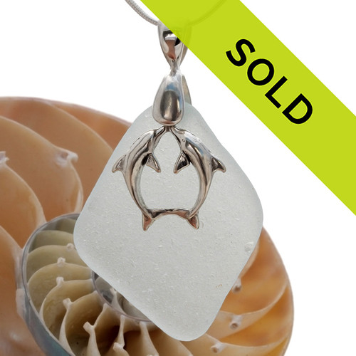 A stunning LARGE  piece of whitish green GENUINE sea glass pendant with a LARGE SOLID STERLING kissing dolphins charm. Sorry this sea glass jewelry piece has  been sold!