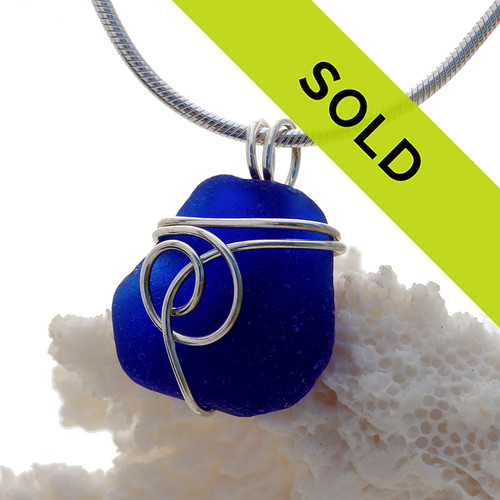 A nice piece of genuine cobalt blue sea glass in simple sterling sea swirl setting. Sorry this sea glass jewelry piece has been sold!