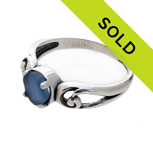 An unaltered blue sea glass piece set in a simple sterling swirl ring. Sorry this sea glass jewelry selection is no longer available.