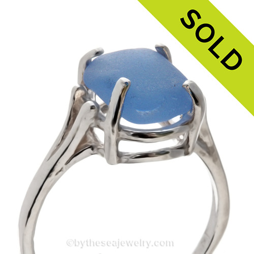 A stunning piece of Carolina Blue beach found Sea Glass piece securely set in a solid sterling silver 4 prong ring. Sorry this Sea Glass Ring has been SOLD!