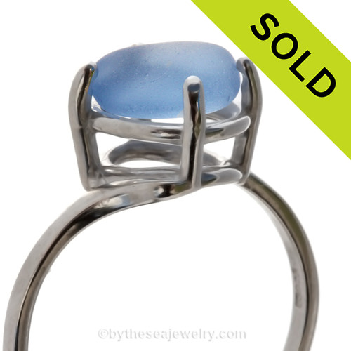 An UNALTERED piece of Carolina blue sea glass set in a ring. Sorry this Sea Glass Ring has been SOLD!