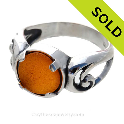 NATURAL Glowing Honey Amber sea glass ring in a solid sterling silver swirl setting. Sorry this Sea Glass Ring has been SOLD!