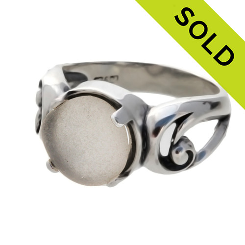 An unaltered beach found white sea glass piece set in a simple sterling swirl ring. Sorry this Sea Glass Ring has been SOLD!