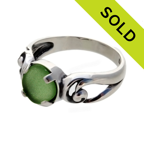 An unaltered beach found green sea glass piece set in a simple sterling swirl ring. SOLD - Sorry this Sea Glass Ring is NO LONGER AVAILABLE!