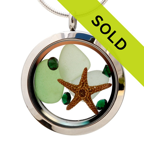 Emerald and green beach found sea glass combined with a real starfish and brightened up emerald green gems . A great sea glass locket necklace for anyone, specially a May Baby! Sorry this sea glass jewelry selection is no longer available!