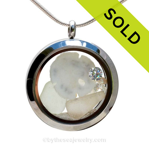 Genuine Sea Glass Locket with a real baby Sandollar and Beach Sand, and brightened up with CZ crystal gems and Pearls.  Diamonds are the April Birthday gemstones, Pearl are for June. SOLD - Sorry this Sea Glass Jewelry Locket is NO LONGER AVAILABLE!