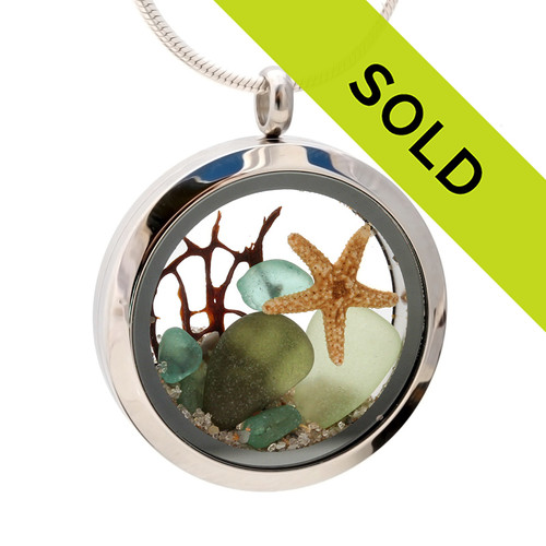 Seafoam, Olive and Aqua Green genuine beach found sea glass combined with a real starfish and seafan, a real underwater scene. Sorry this sea glass jewelry selection has been sold!