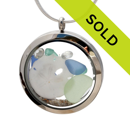 Blue and seafoam sea glass  combined with pearls and a mini real sandollar. Beach sand makes this your own personal beach on the go! Sorry this sea glass jewelry seleciton has been sold!