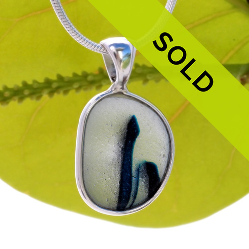 A stunning ribbon of deep teal runs straight through this amazing sea glass pendant piece. Sorry this sea glass jewelry piece has been sold!