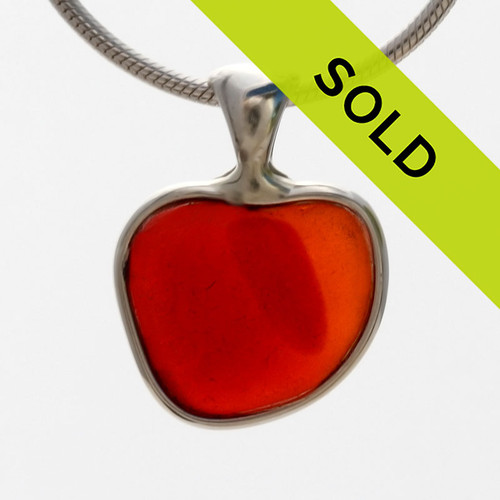 A  natural beach found mixed petite Amberina Red sea glass heart set in our Deluxe Wire Bezel© A great necklace for any time of year and perfect for any sea glass lover! Sorry this ultra rare sea glass jewelry piece is no longer available.